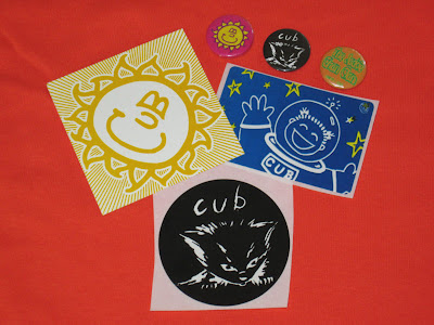 one cub sun logo button, one cub Box Of Hair kitten button, and one Jackie Chan Clan button (cub's one-off alter ego) PLUS vintage cub stickers