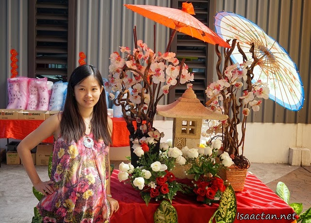 Janice posing with one of the Japanese themed decor setup by Shogun at the venue