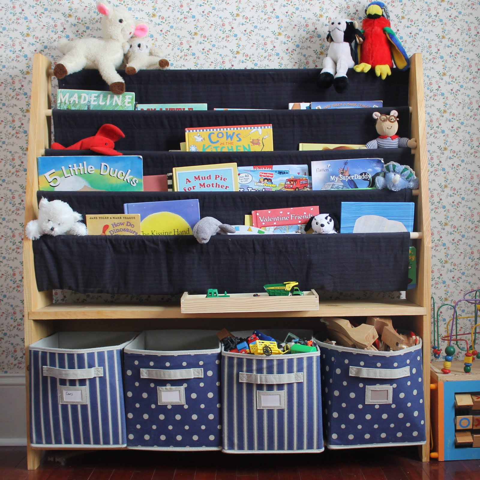 born imaginative sling bookshelf with storage bins for kids