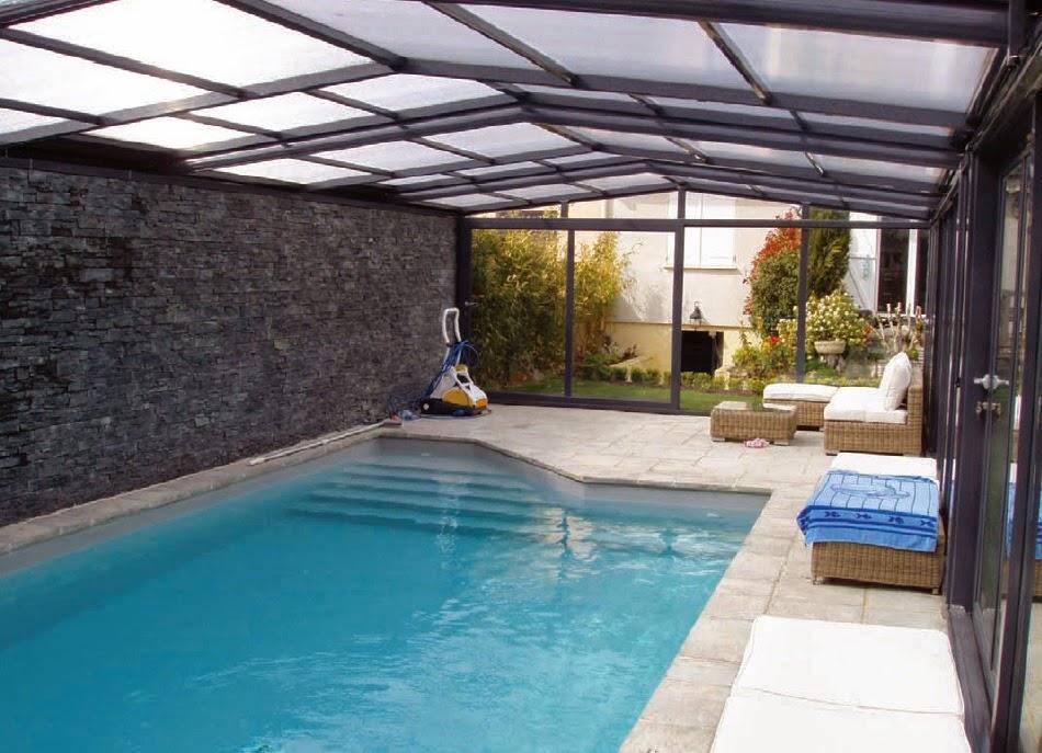 Construction de piscines v randa for Abris de piscine venus international