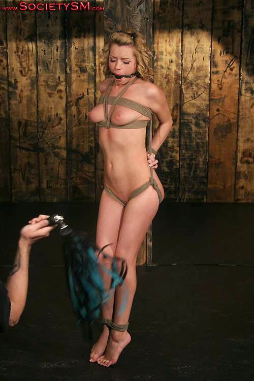 tied up and tortured with a whip