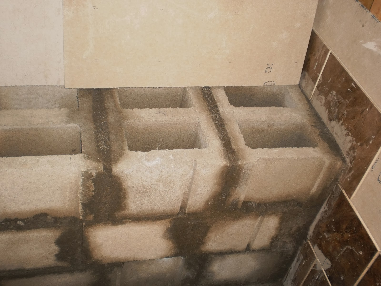 inside shower benches wood or concrete block