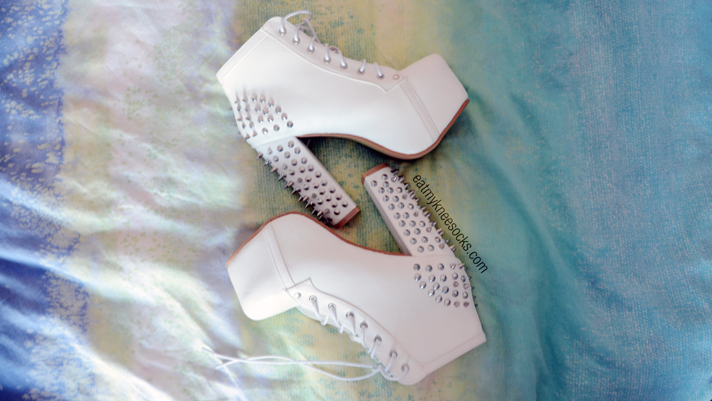 Side views of the spiked white high-heel booties from Milanoo, similar to Jeffrey Campbell's popular Lita booties.