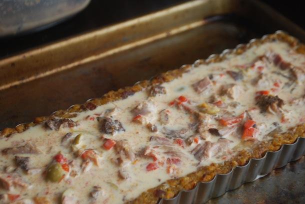savory braised pork tart with puerto rican mofongo crust
