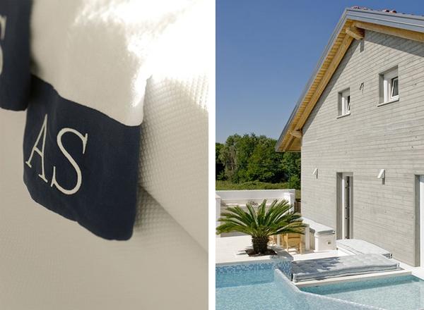 Detalle de las toallas y vista general de la casa con piscina