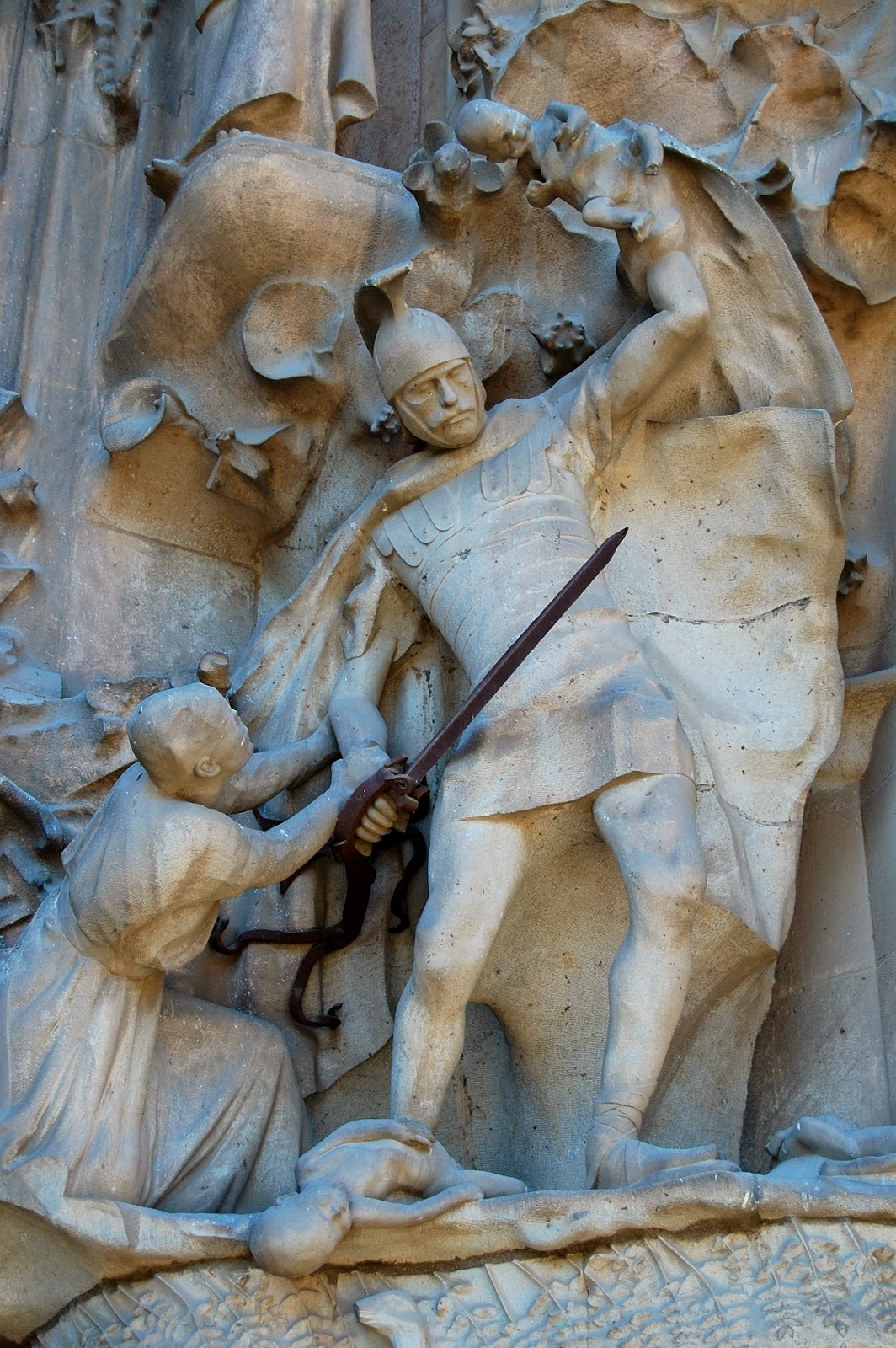Roman legionnaire slaughters infants in the Portal of Hope, Nativity Facade