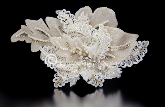 http://cassandralynne.com/collections/gold-bridal-hair-accessories/products/vintage-lace-wedding-hair-clip-with-pearls-and-rhinestones