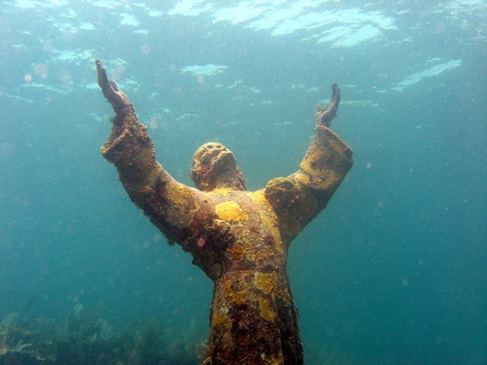 Christ of the Abyss is a submerged bronze statue of Jesus, of which the original is located in the Mediterranean Sea off San Fruttuoso between Camogli and Portofino on the Italian Riviera. It was placed in the water on 22 August 1954 at approximately 17 metres depth, and stands c. 2.5 metres tall. Various other casts of the statue are located in other places worldwide, both underwater and in churches and museums. The sculpture was created by Guido Galletti after an idea of Italian diver Duilio Marcante. The statue was placed near the spot where Dario Gonzatti, the first Italian to use SCUBA gear, died in 1947. It depicts Christ offering a blessing of peace, with his head and hands raised skyward.