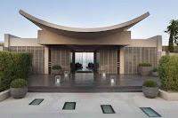Foto de fachada de casa moderna con techo ovalado