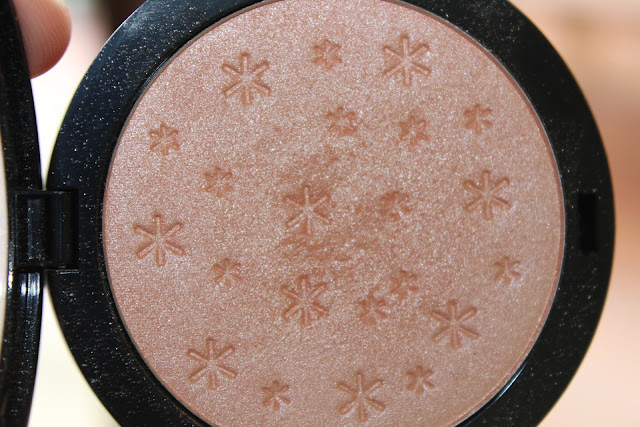 close up of rose gold highlighter