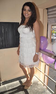 tashu kaushik in white short dress giving interview