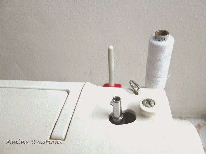 how to put a bobbin in a sewing machine