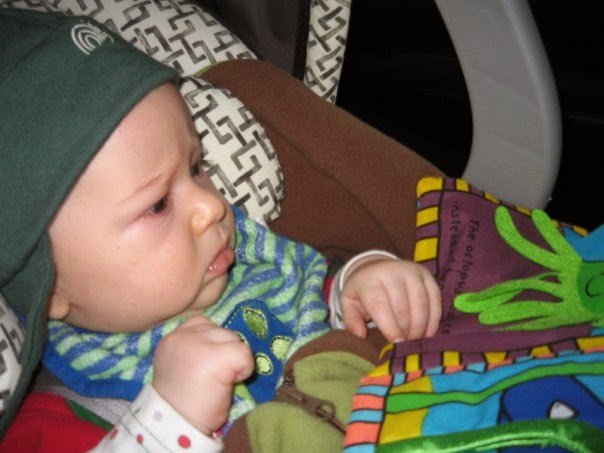 the Little Man reading as a baby on OneQuarterMama.ca