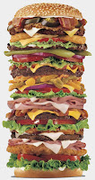 Picture of a extremely tall hamburger