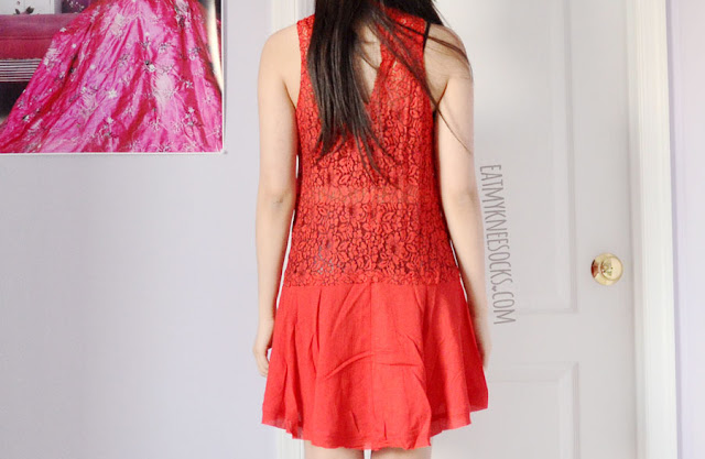 A bright, bold, boho-chic outfit featuring SheIn's red dress, a dupe of the Free People Cross My Heart in Lace Tunic, a Brandy Melville Jeanne Bralet-inspired vest, and spiked black Jeffrey Campbell Lita platform booties dupes.