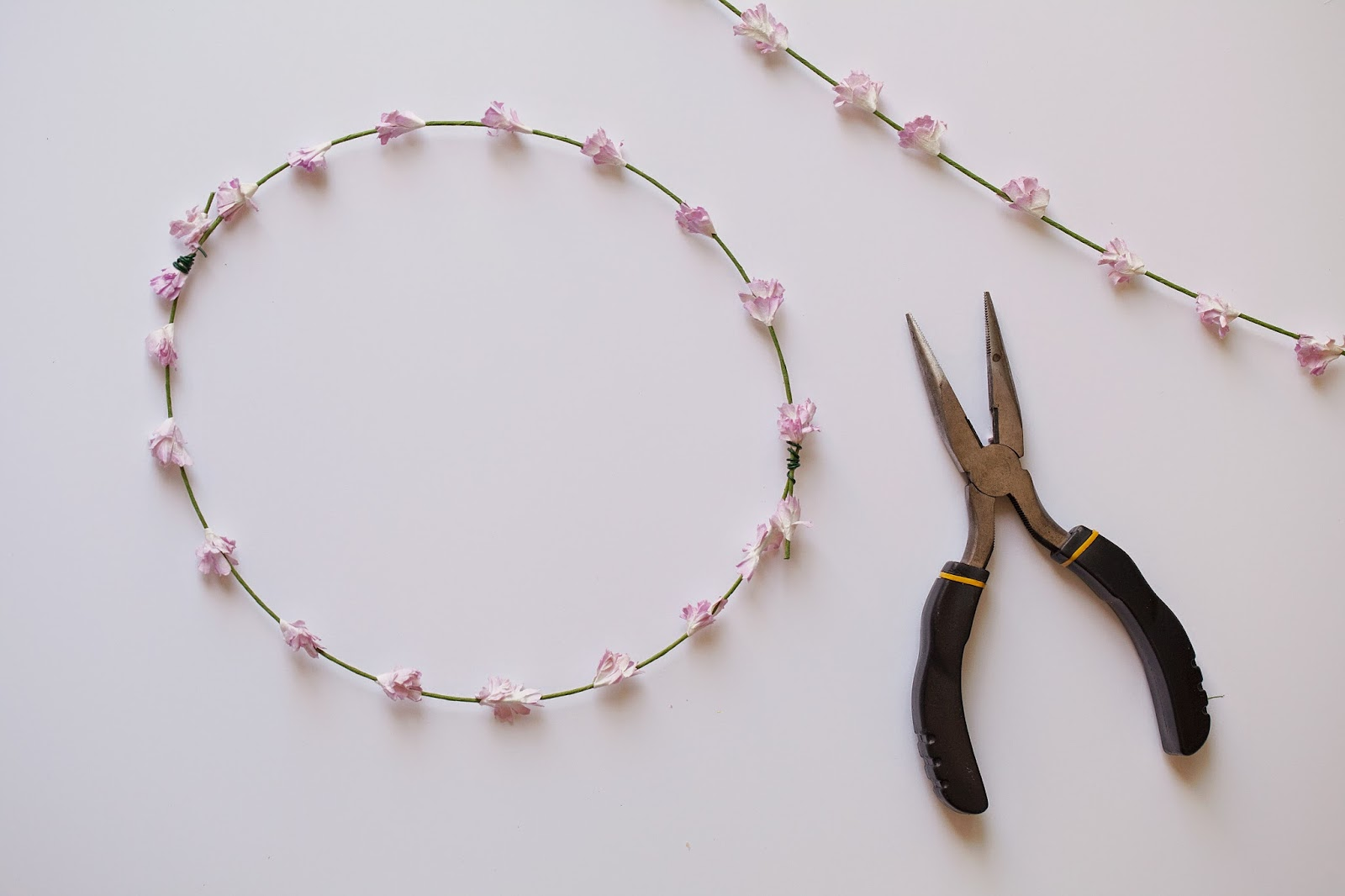 Tell diy summer floral crown tell love and party start adding filler stems like the white one below secure them to the crown with a small piece of wire adding additional pieces of wire where necessary izmirmasajfo