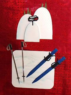 ski hills, skis with poles, gift bag