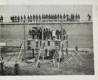 Four conspirators in President Lincoln's assassination are hanged July 7, 1865.
