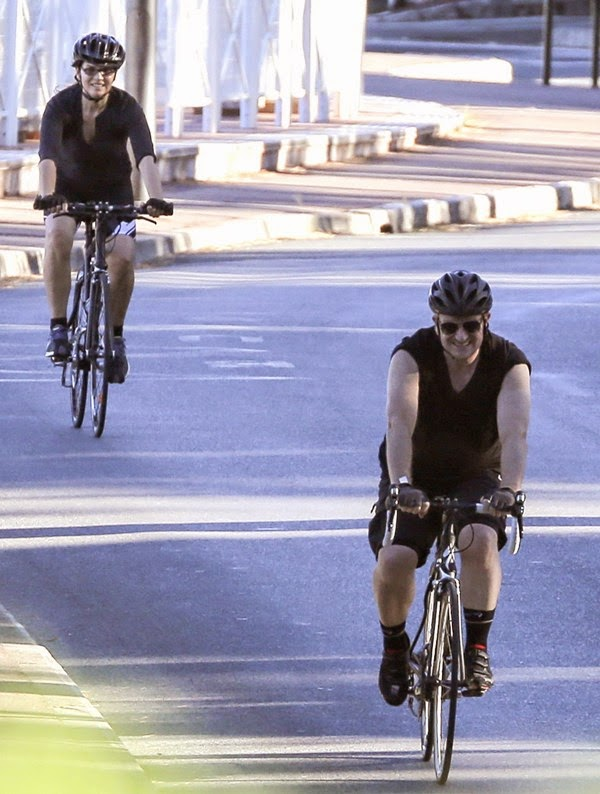 Bono riding a bicycle in Central Park,  NYC< New Your City.