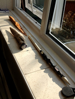 Wands and athames drying on the windowsill in the sun