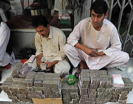 Afghani money changers