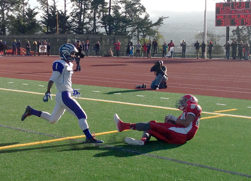 El Camino football player Andres Abarca falls after catching a touchdown pass.
