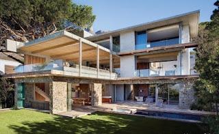 villa de lujo fachada piedra y cemento