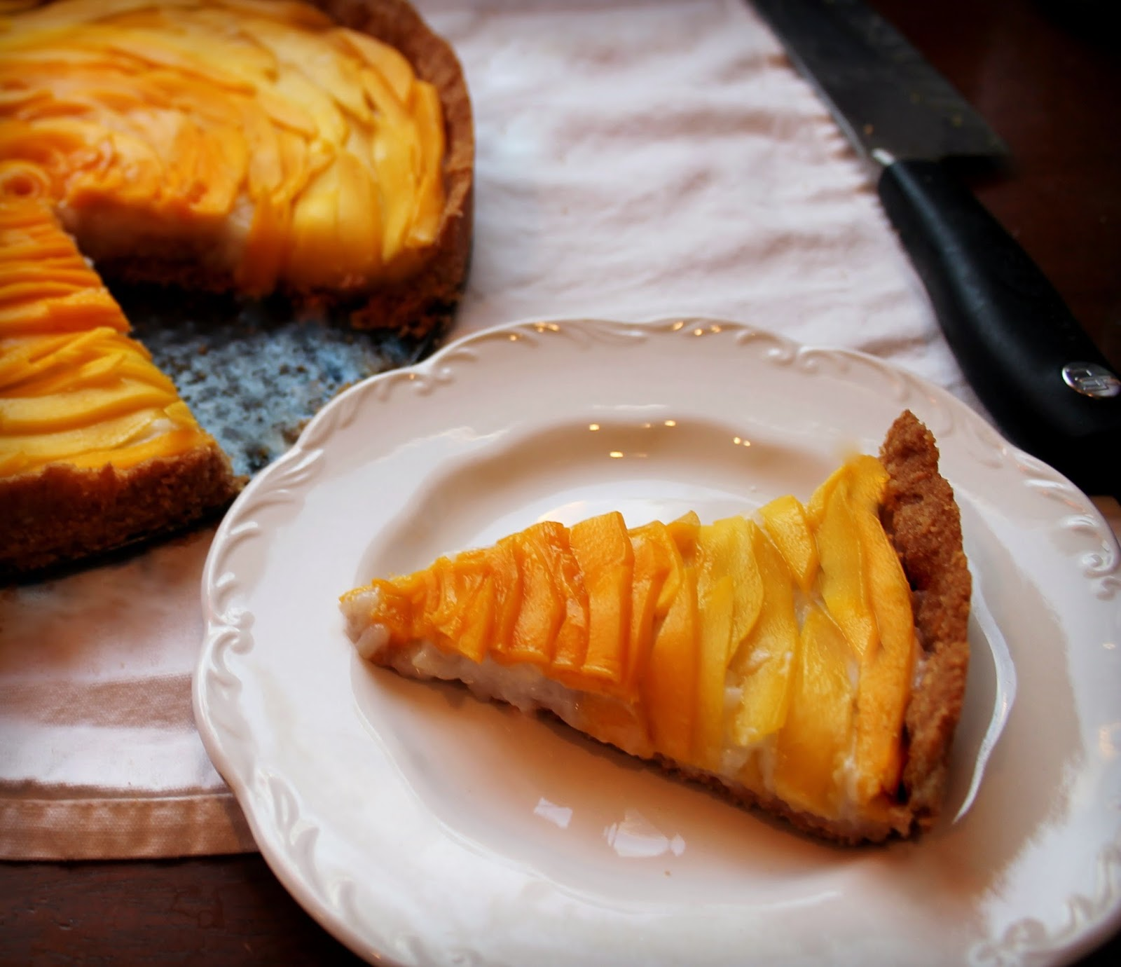 mango sticky rice inspired tart with coconut cashew crust crust