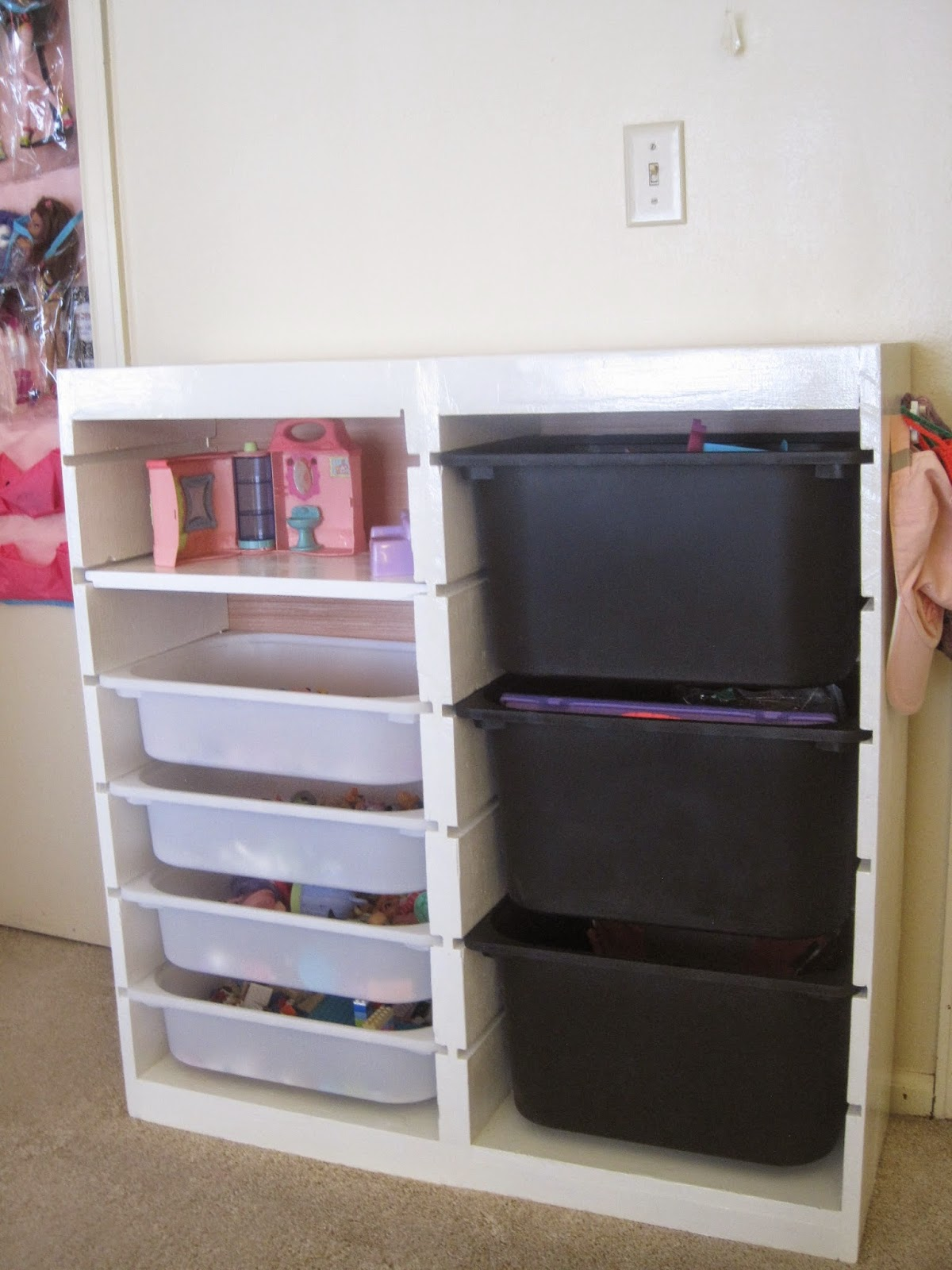 The Girlu0027s Storage Unit. She Requested One Slot Be Used For A Shelf Instead  Of A Bin. We Also Attached 2 Drawer Pulls To One Side To Be Used As Hooks.
