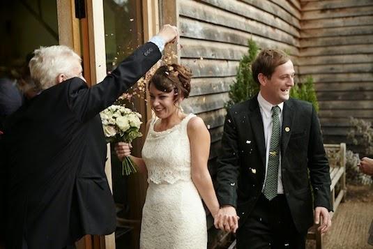 Clare and Ed enter reception, with confetti