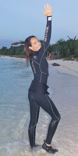 wetsuit model on beach