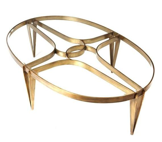 Oval coffee table in solid brass with beveled glass top