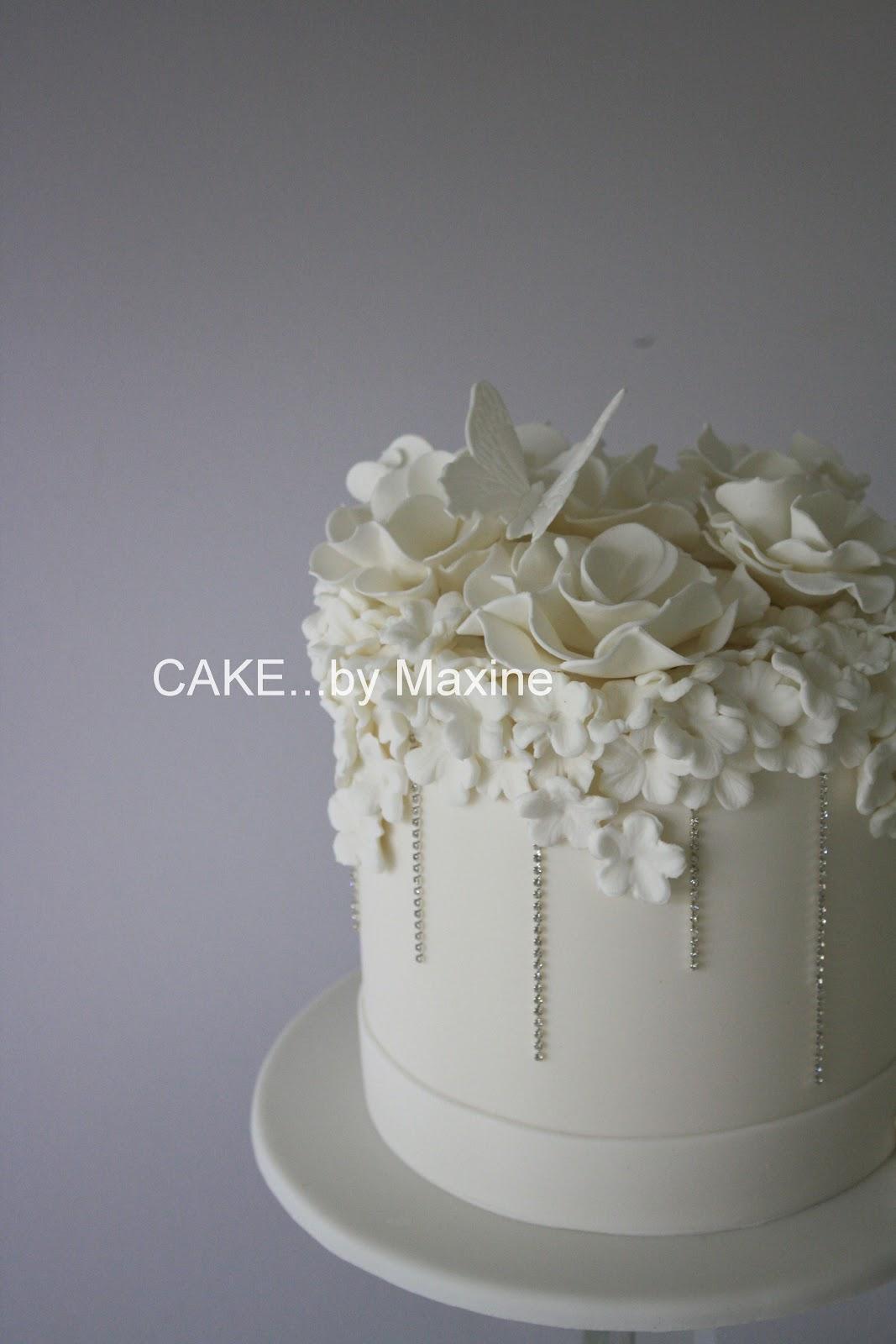 ManyWhiteBowls WHITE WEDDING CAKE WITH BLING