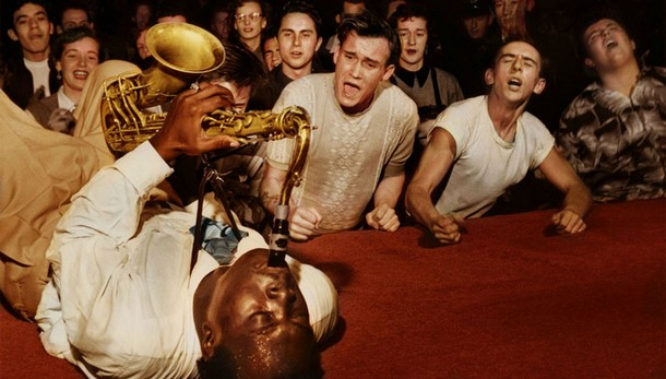Big Jay McNeely driving the crowd at the Olympic Auditorium into a frenzy, Los Angeles, 1953