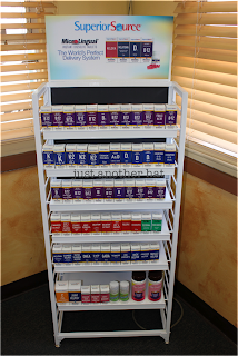 Superior Source™ Vitamins in marketing display rack