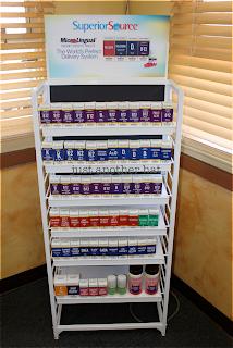 Superior Source™ Vitamins in marketing display rack