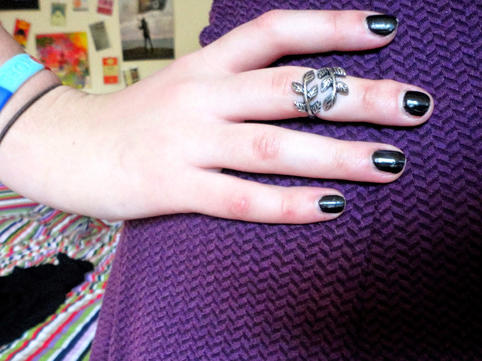 silver leaf ring with black nail polish & purple dress
