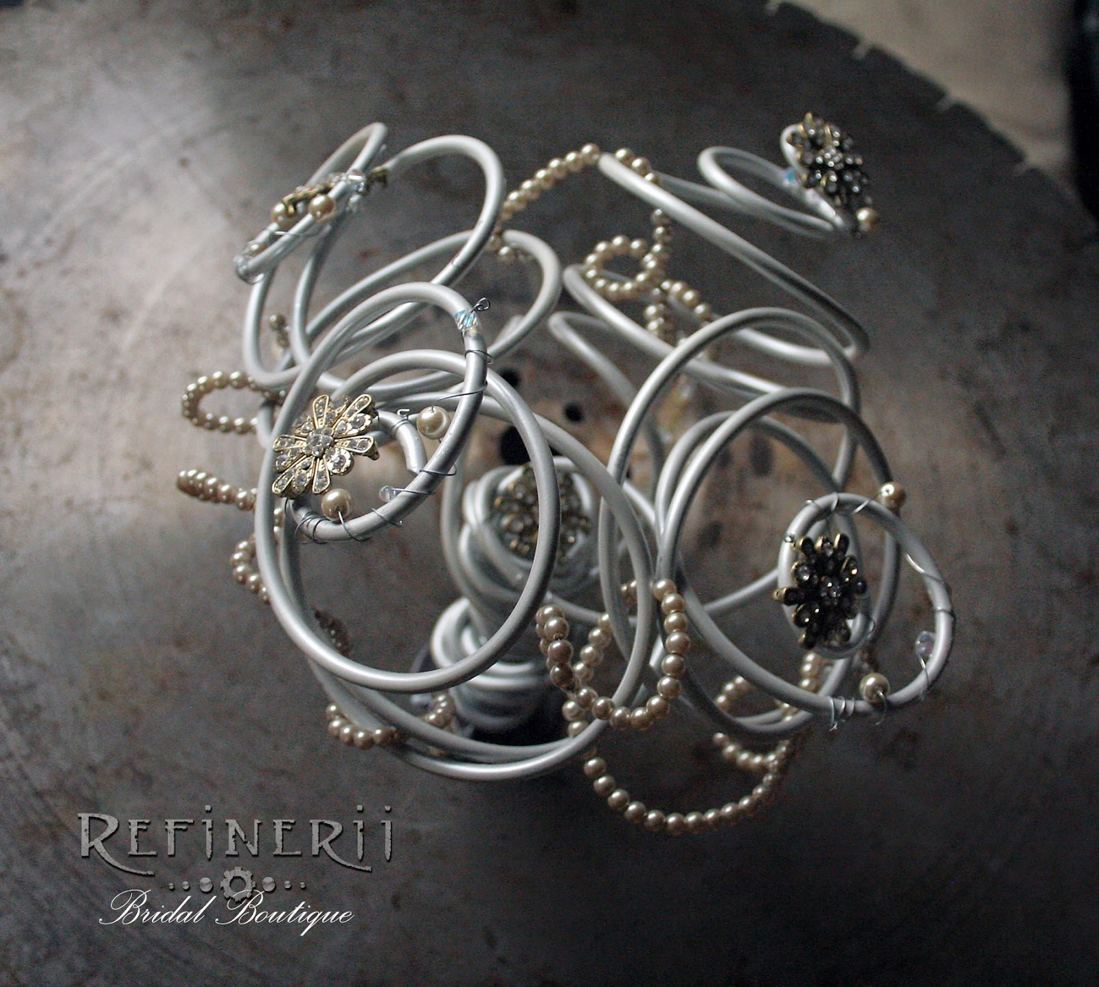 Alternative metal bouquet by RefineriiBridal with pearls & rhinestones
