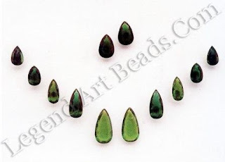 The Indian fascination for Colombian emeralds continued well into the 18th and 19th centuries. However, by the late 19th century, many of these stones, hitherto left in their natural state, were re-cut with facets. These pear-shaped emeralds were collected over a period of time to achieve size gradations and match depth of colour. The two large ones in the centre are believed to have originally belonged to the Nizam of Hyderabad.