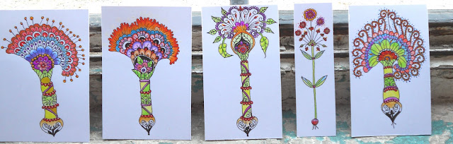 Picture of all my miniature colourful flower drawings lined up against the window