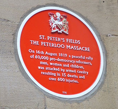Photograph of the memorial plaque on the former site of the Free Trade Hall