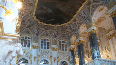 An incredible ceiling painting above the grand staircase inside the Hermitage.