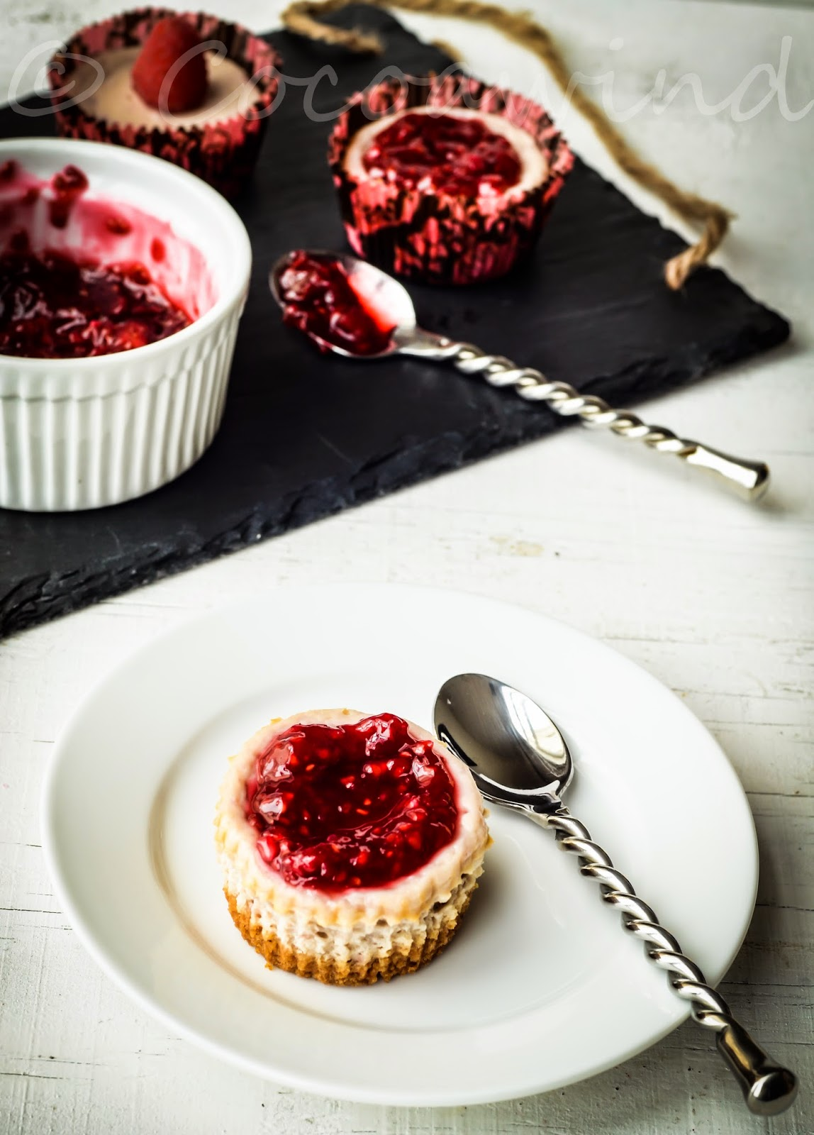 Individual Raspberry Cheesecakes topped with Raspberry Compote