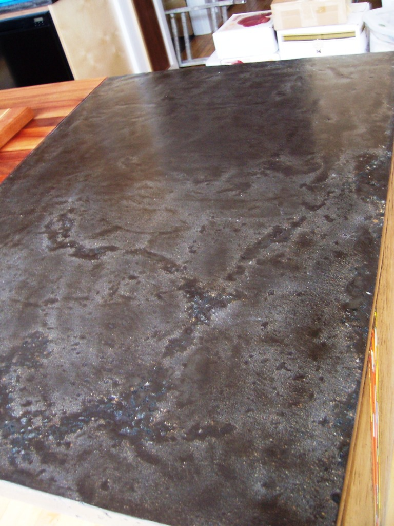 Z Countertop Stain : This was a quikrete mixture with black granite seeded on the surface ...