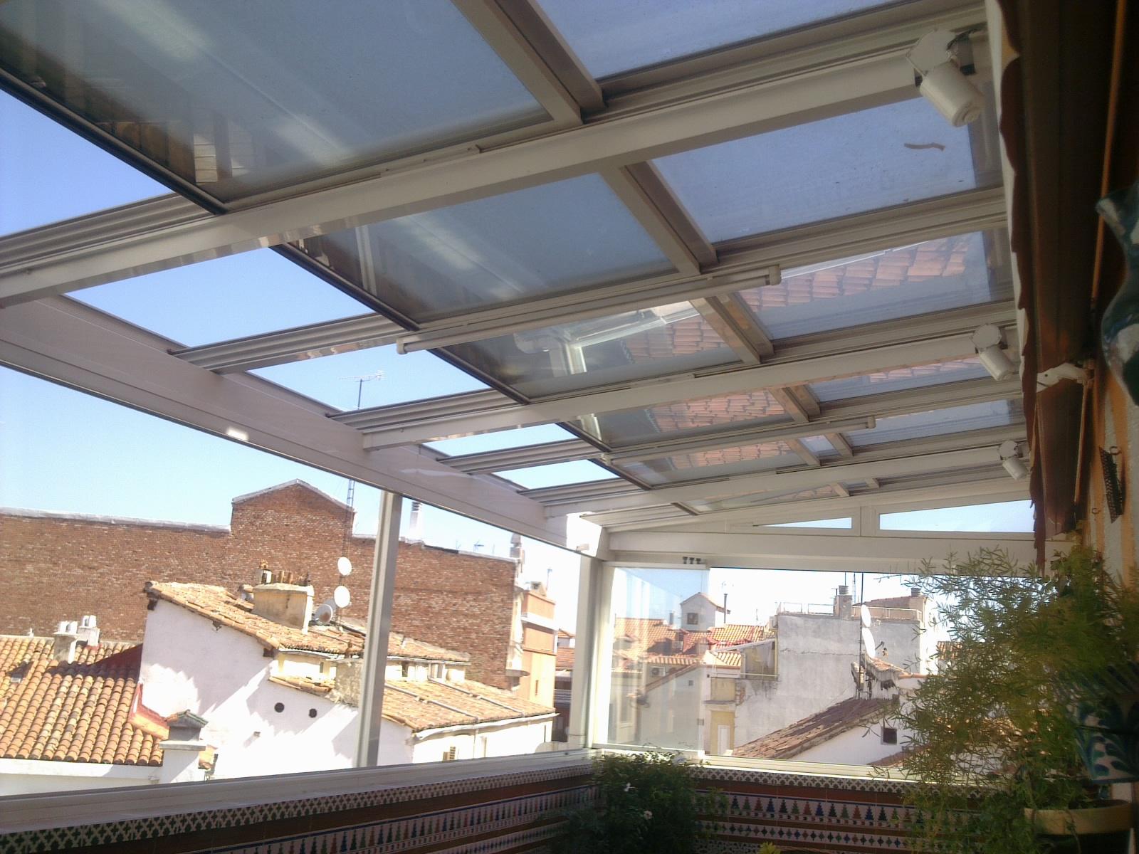 Carpinteria met lica y techos moviles reforma en madrid for Techo policarbonato transparente