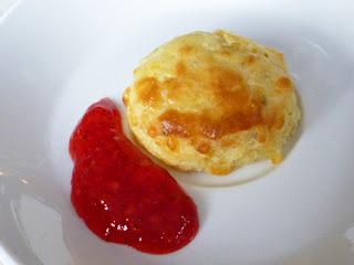 Rosemary and cheese scone with fresh, homemade strawberry jam