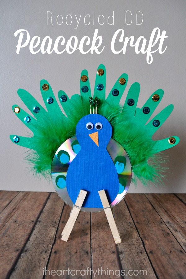Recycled cd peacock craft for kids i heart crafty things for Hand works with waste things