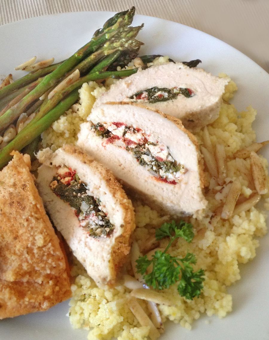 Image of Greek Chicken atop Lemon Couscous with a side of Asparagus garnished with almond slivers