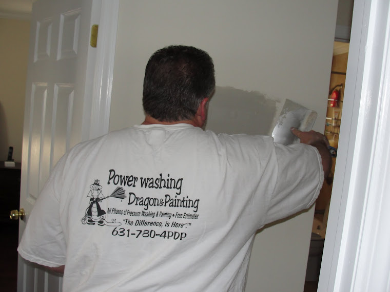 Ed using tape and spackle to make drywall repairs, Long Island NY