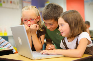 Kids using a mac